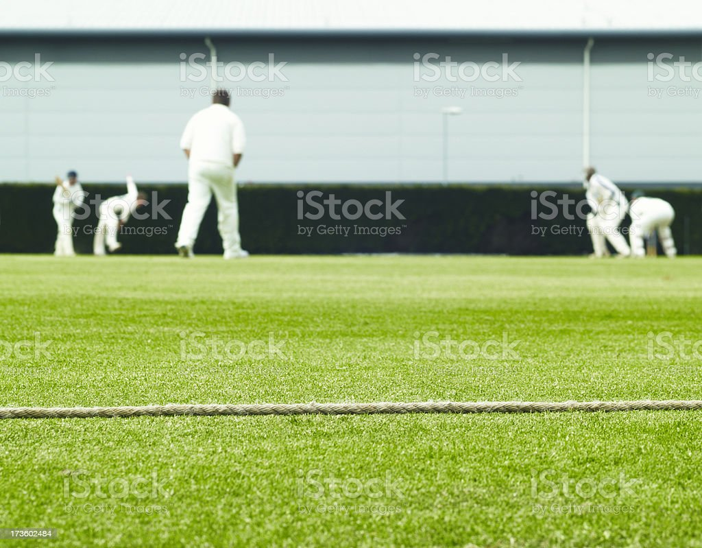 Cricket boundary rope and match action royalty-free stock photo