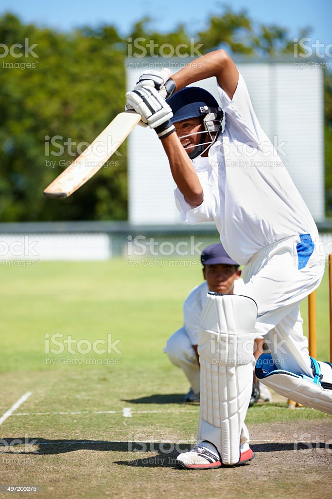 Cricket can be fiercely competitive stock photo