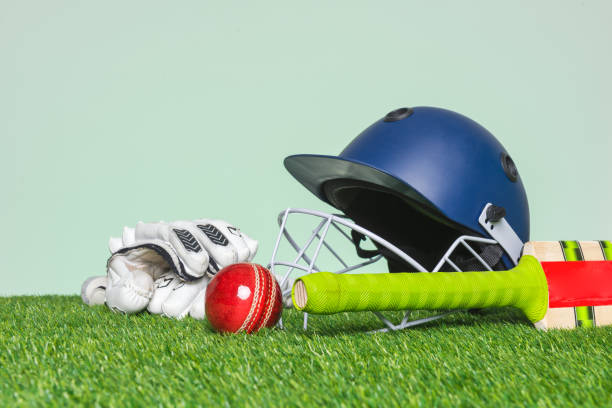Cricket equipment on grass stock photo