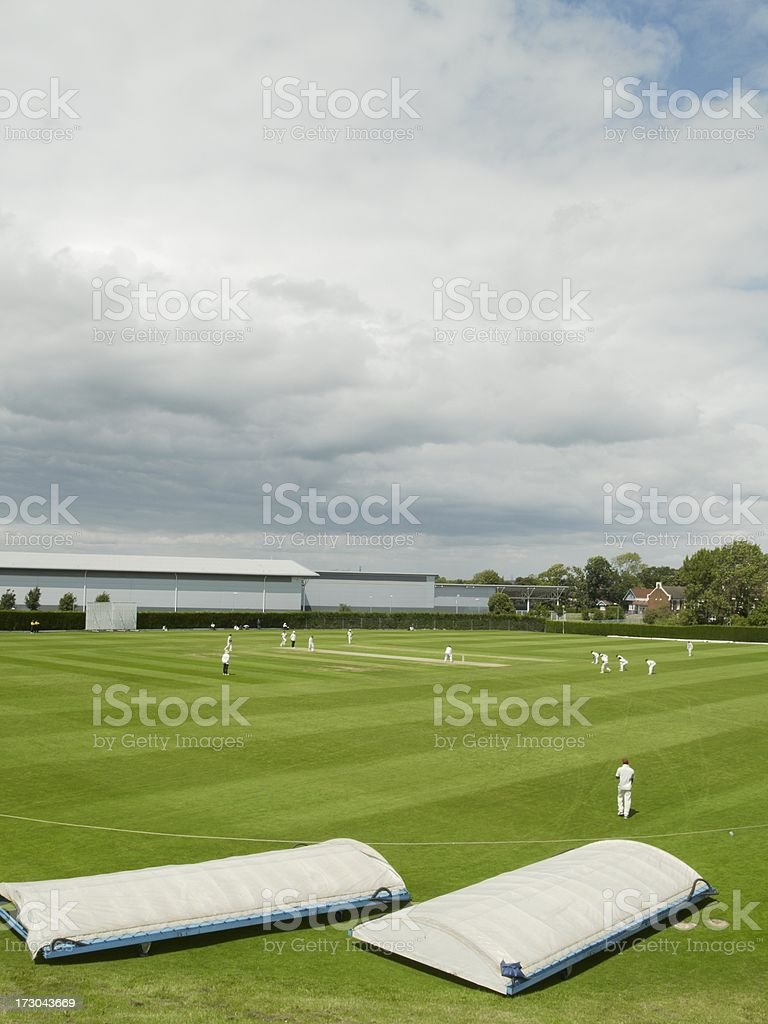 Cricket match and covers under storm clouds royalty-free stock photo