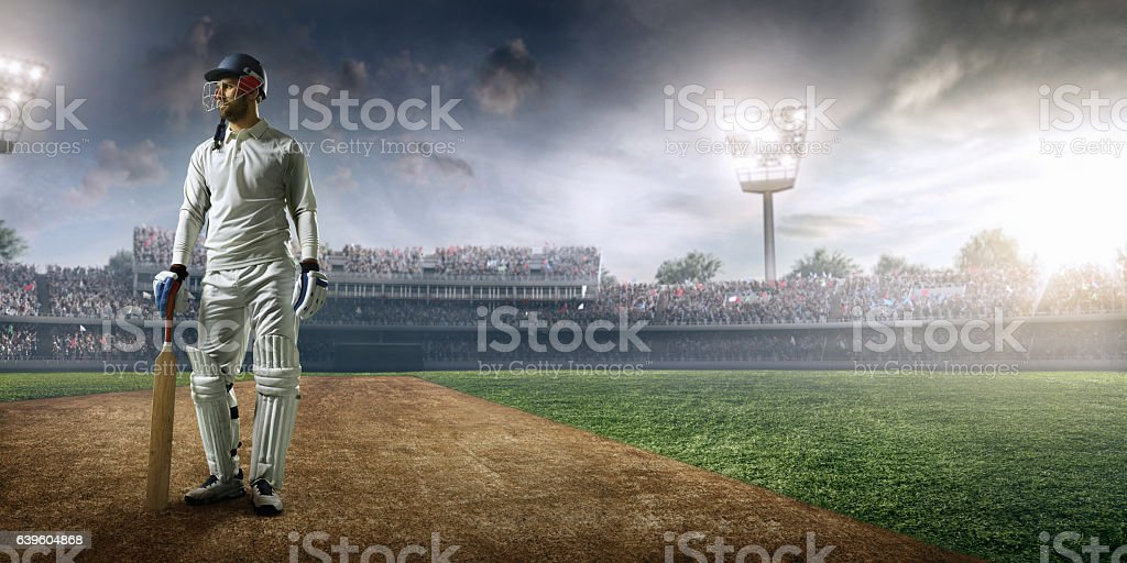 Cricket player batsman on the stadium - foto de stock