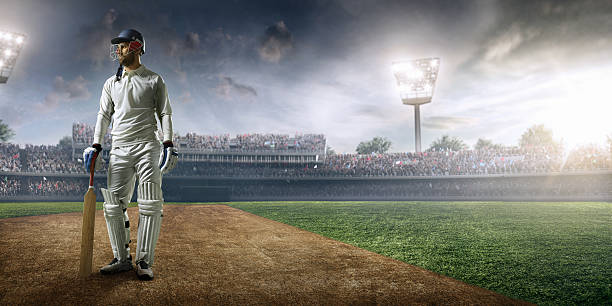 Cricket player batsman on the stadium - Photo