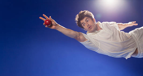 Cricket player catching ball  catching stock pictures, royalty-free photos & images