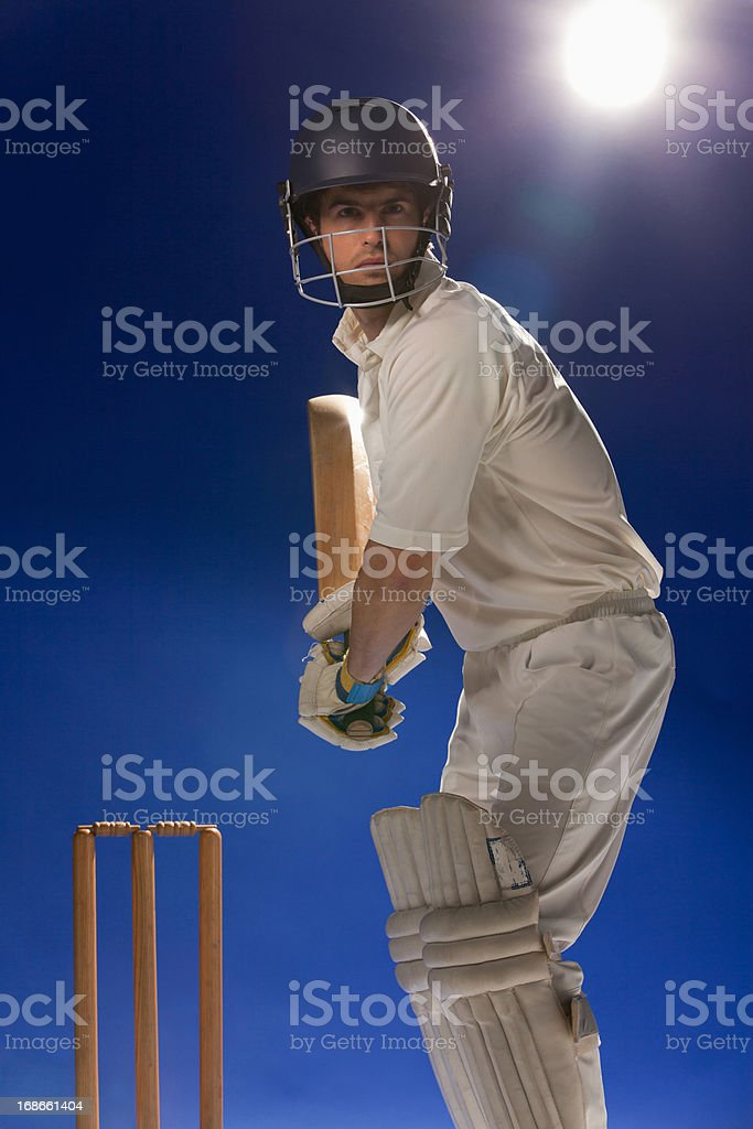 Cricket player holding bat stock photo