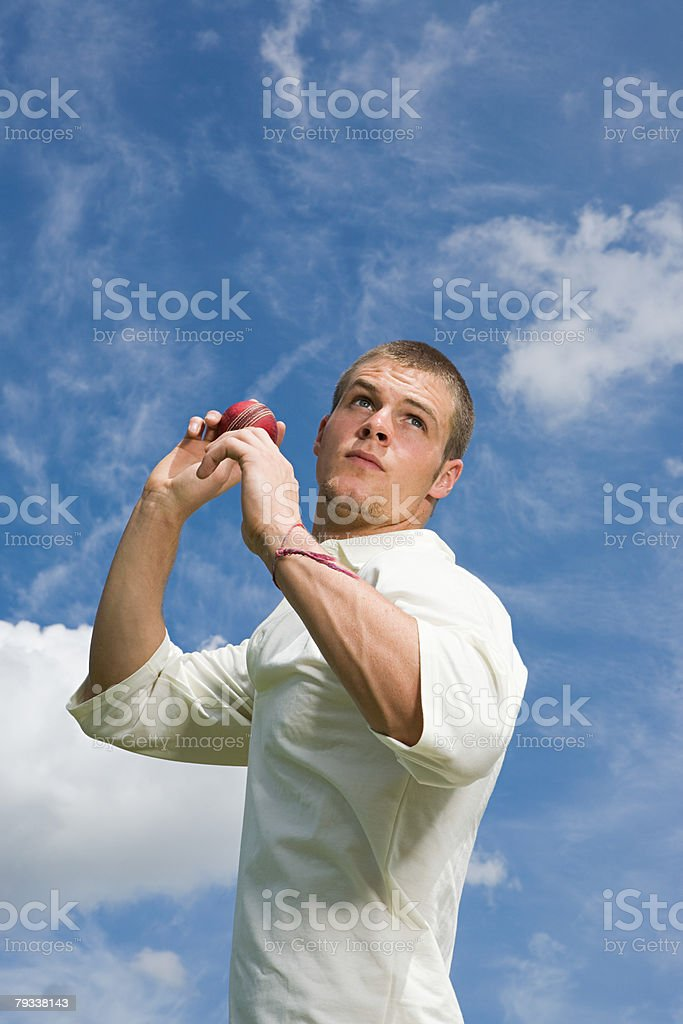 A cricket player throwing a cricket ball royalty-free stock photo