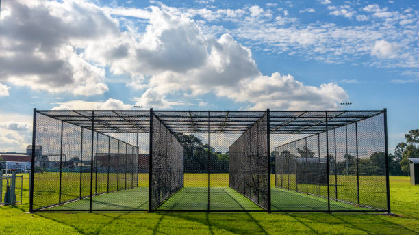 A cricket pratice net on green grass in Melbourne, Victoria, Australia stock photo