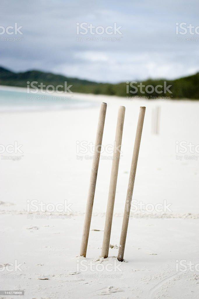 Cricket stumps on a deserted beach stock photo