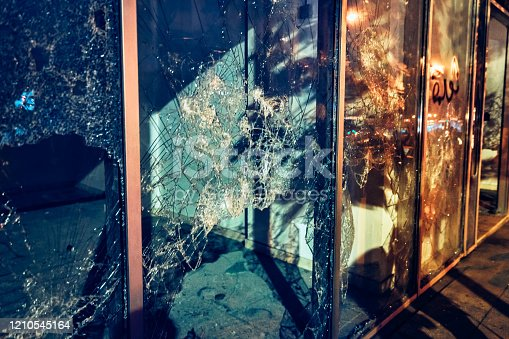 Photojournalism, broken shopfront, crime night scene, the background of a damaged showcase of shops, the consequences of revolution, Beirut, Lebanon