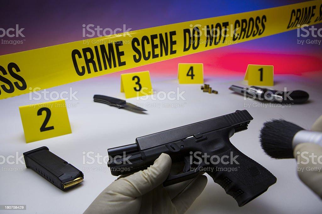 Crime scene do not cross, with auto pistol stock photo