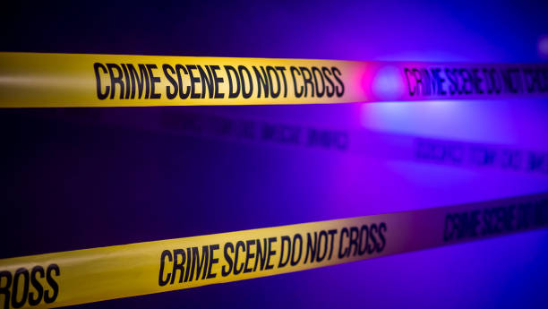 Crime scene fenced with ribbons Crime Scene Tape Don't Cross. crime stock pictures, royalty-free photos & images