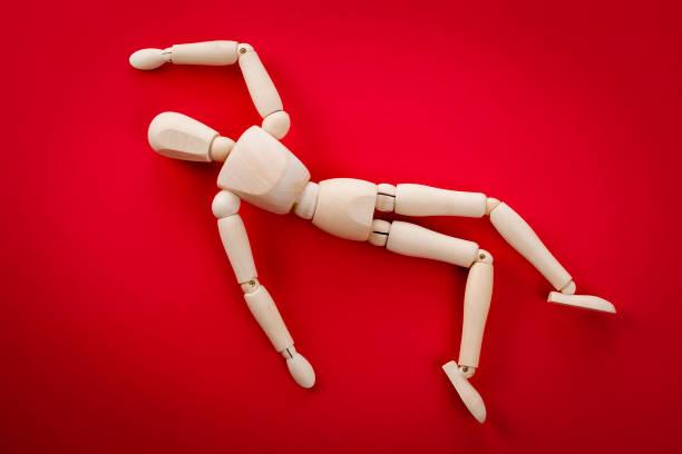 Scène de crime: représentation humaine d'un cadavre s'étendant sur le sol - Photo