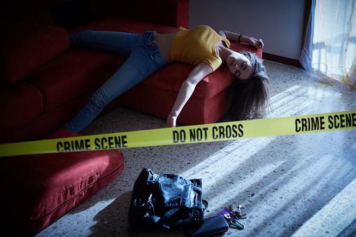 Crime Scene Imitation Lifeless Woman Lying On The Sofa