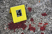 Crime scene investigation, Blood stain against the crime marker on the ground. (Selective Focus)