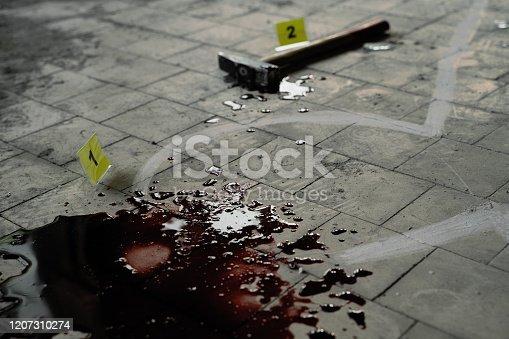 Crime scene investigation, chalk outline of victim body, blood and hammer.