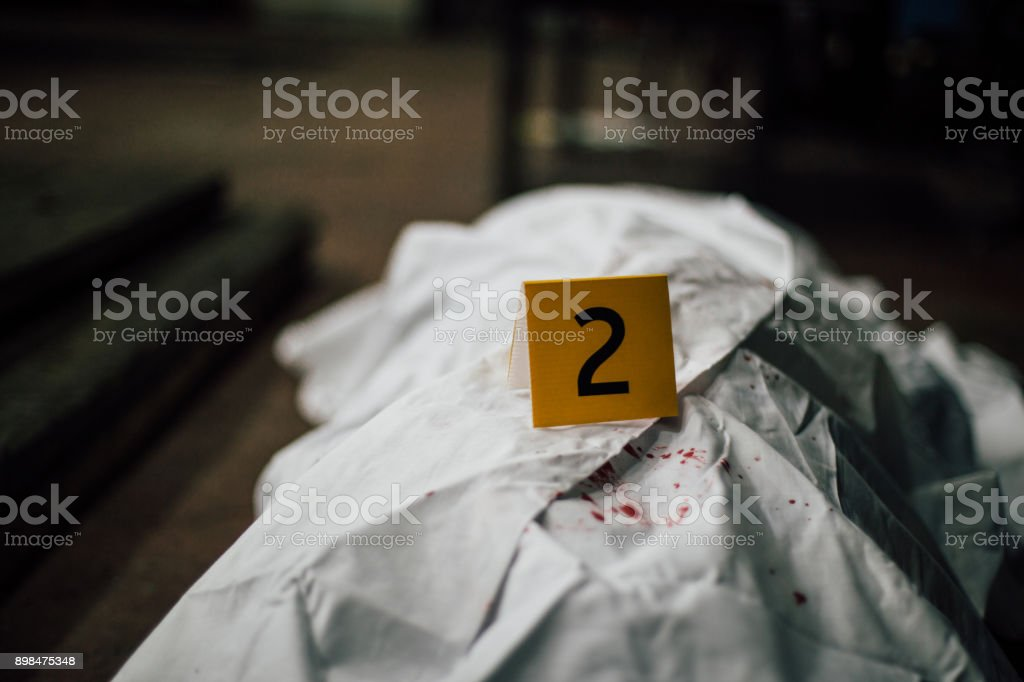 Crime Scene Investigation Dead Body Cover With A White Sheet Stock