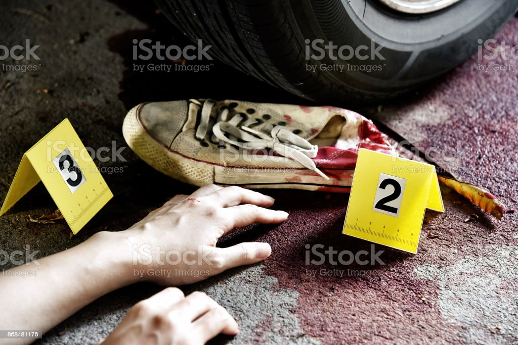 Crime scene investigation evidence and crime marker, Accident on the road, Car crash, Blood body lying on the street hit by a car. stock photo
