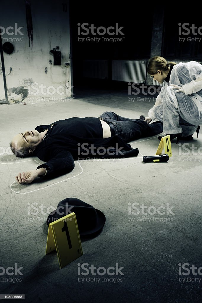Crime Scene Investigation, Woman Outlining Man's Body in Chalk stock photo