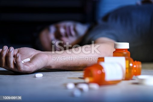 Crime Scene:  man dies from prescription drug overdose.  Opioid addiction themes.