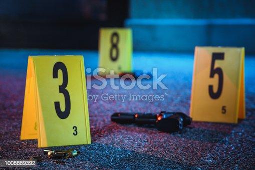 Bullet casings in blood. Crime scene.