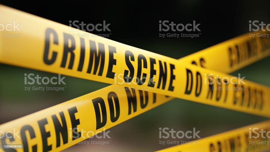 Crime Scene Tape Barrier In Front Of Defocused Background stock photo