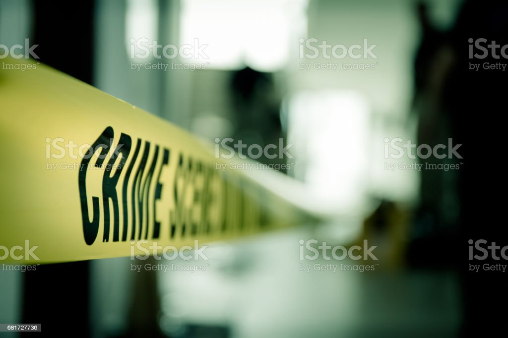 crime scene tape of  mysterious case in cenematic tone with copy space stock photo