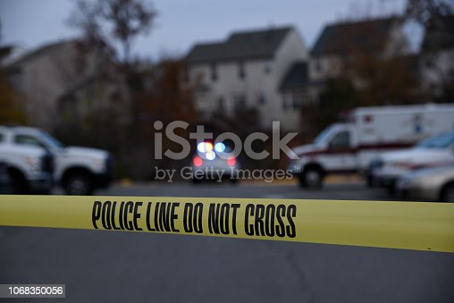 istock Crime scene with a marked police cruiser 1068350056