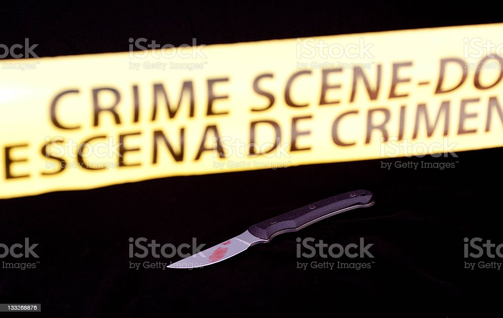Crime scene with English and spanish barrier tape stock photo