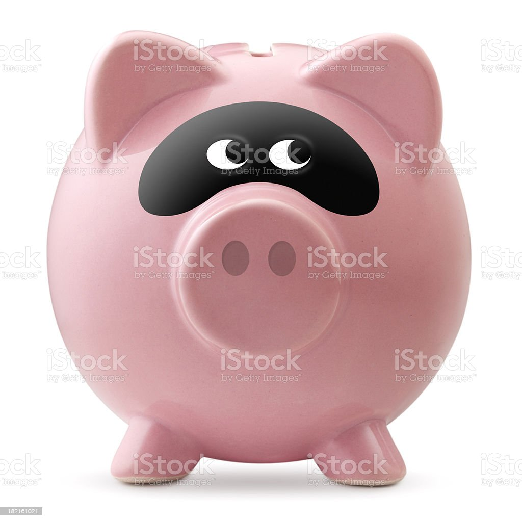 Criminal activity. Piggy bank with a bandit mask stock photo