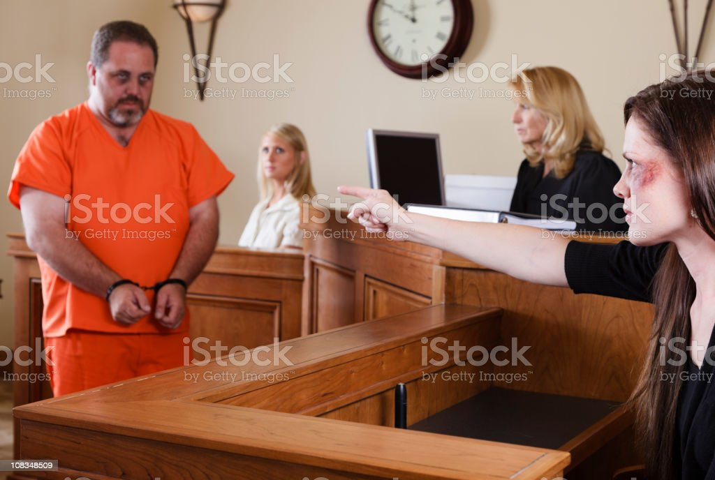 Criminal and Victim in Court stock photo