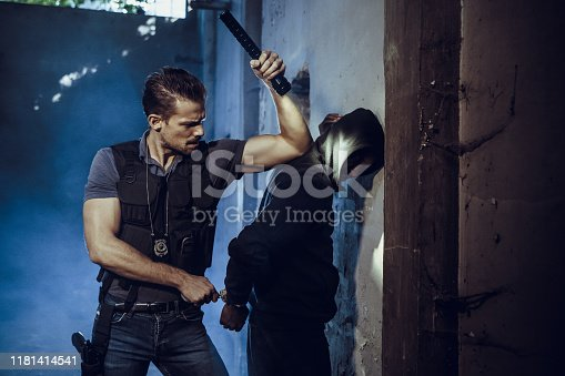 Policeman arresting young male bandit