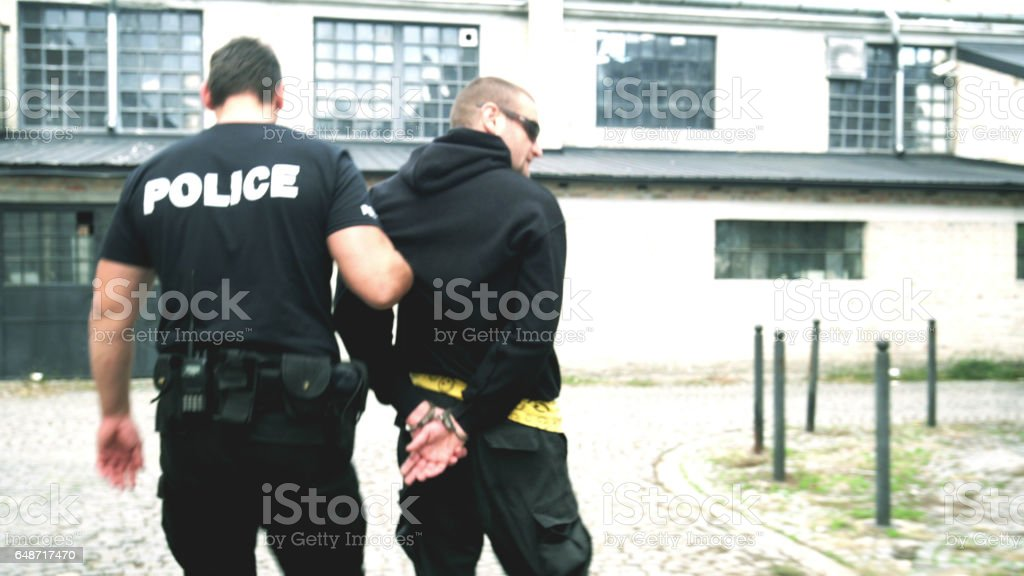 Criminal arrest stock photo