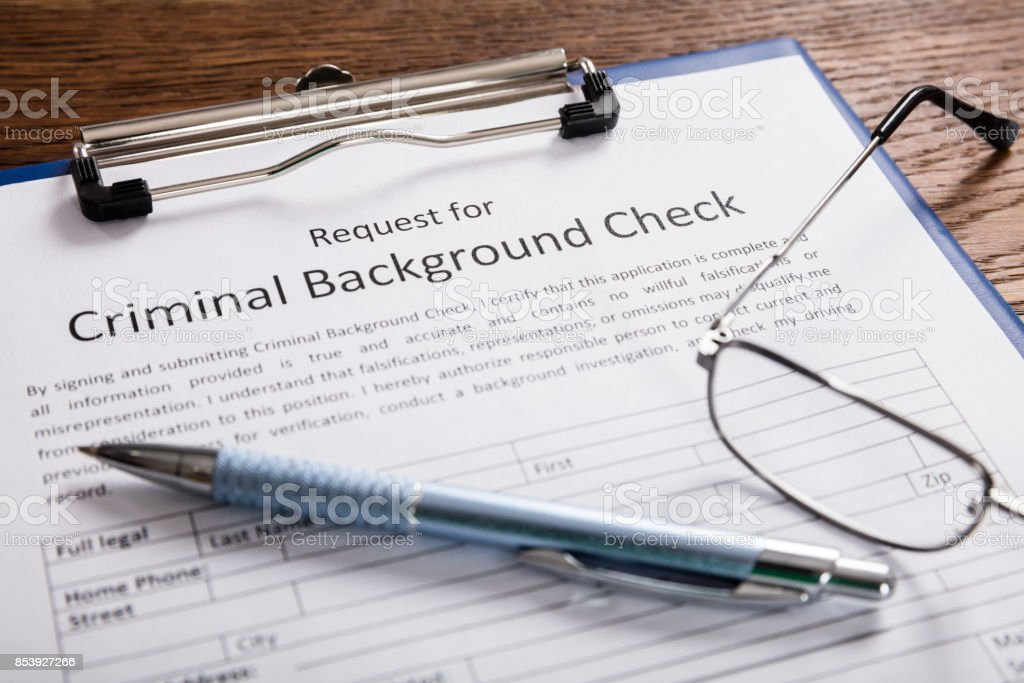 Criminal Background Check Application Form With Pen stock photo
