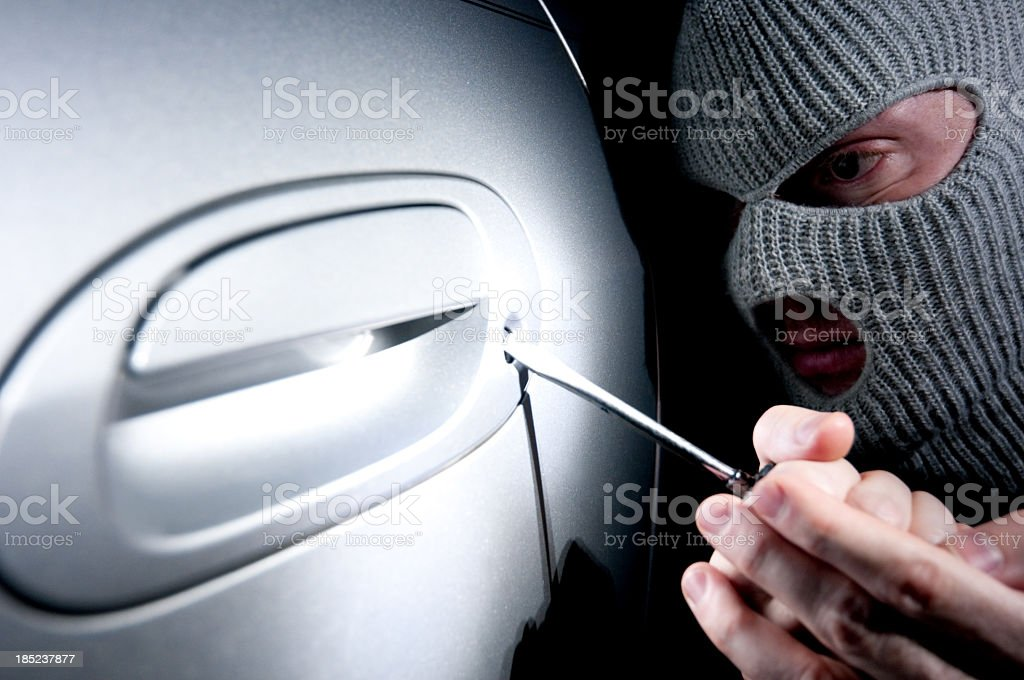 Criminal breaking into a car royalty-free stock photo