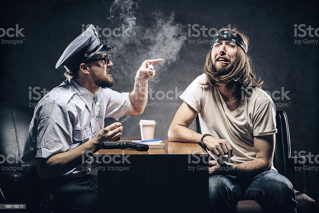 Criminal Gets Police Chief Interrogation royalty-free stock photo