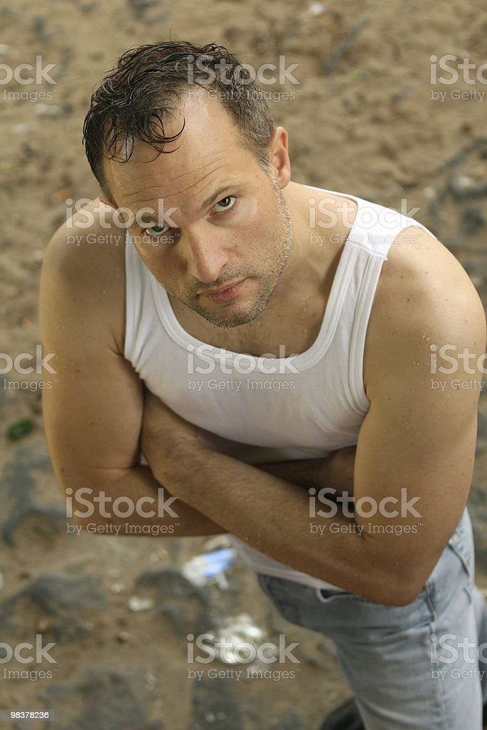 criminal guy in undershirt royalty-free stock photo
