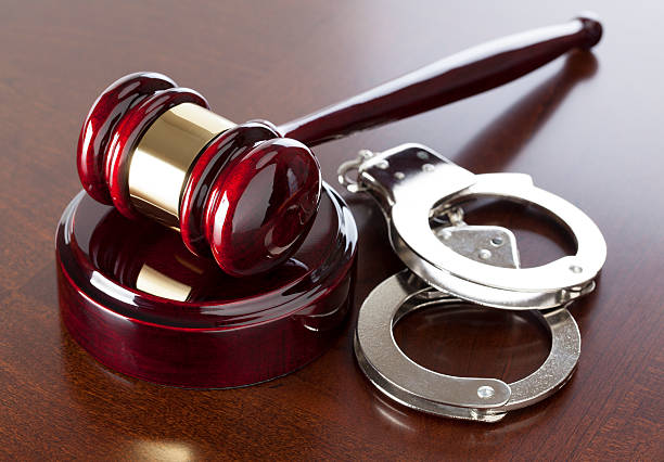 Criminal Law Gavel & Handcuffs on wood table. CLICK TO SEE MORE! criminal stock pictures, royalty-free photos & images