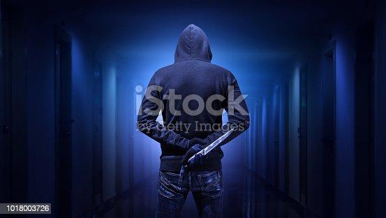 Criminal or bandit holding a knife.