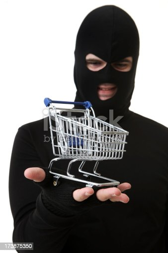 istock Criminal or Thief on White Holding Trolley 173875350