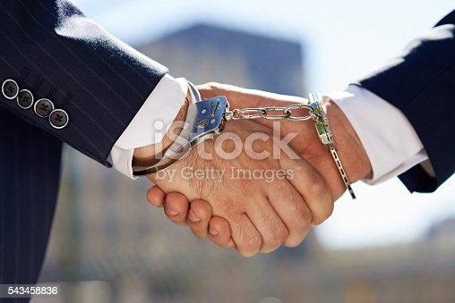istock Criminal partnership 543458836