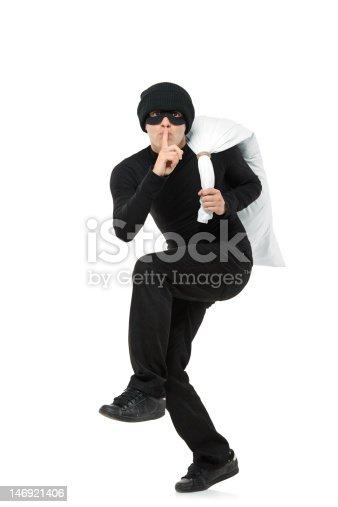 istock Criminal running away carrying a bag 146921406