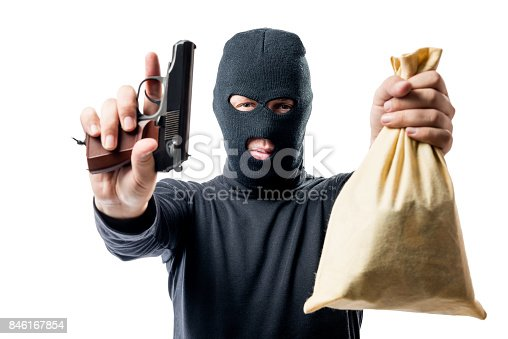 istock criminal with a bag of money was arrested, a robber understands his hands up 846167854