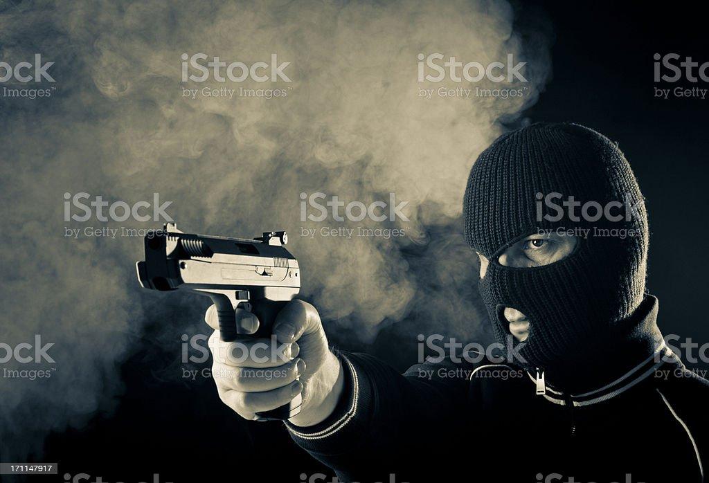 Criminal with gun royalty-free stock photo