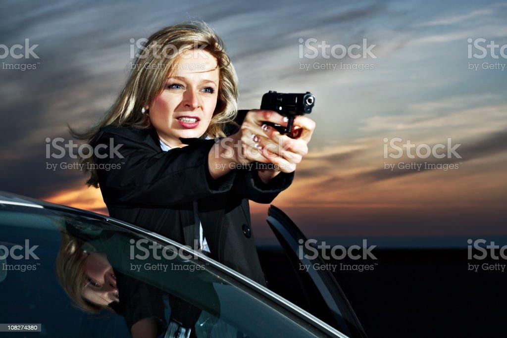 Criminal Woman against a Car stock photo