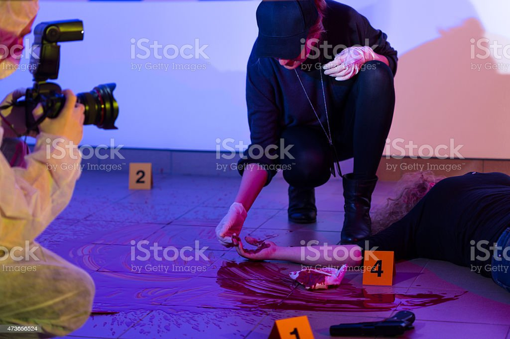 Criminalist working on a crime scene stock photo