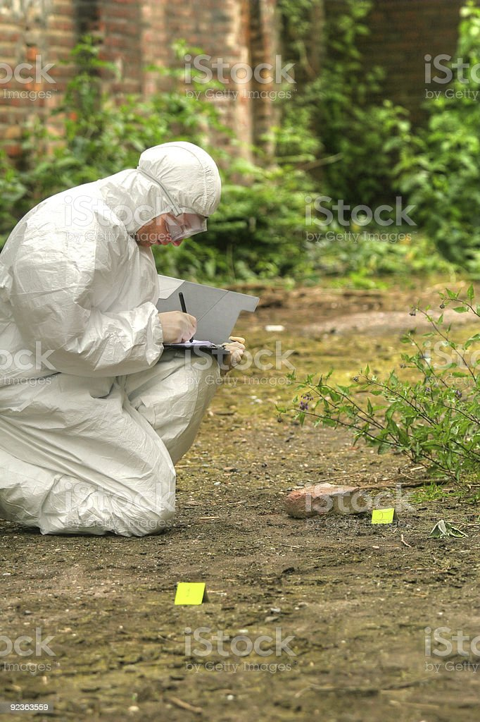criminologist makes short notices royalty-free stock photo