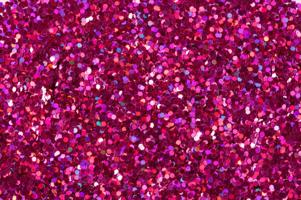 crimson glitter shiny background - magenta stock photos and pictures