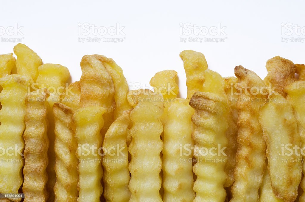Crinkle Cut Oven Chips or French Fries White Background stock photo