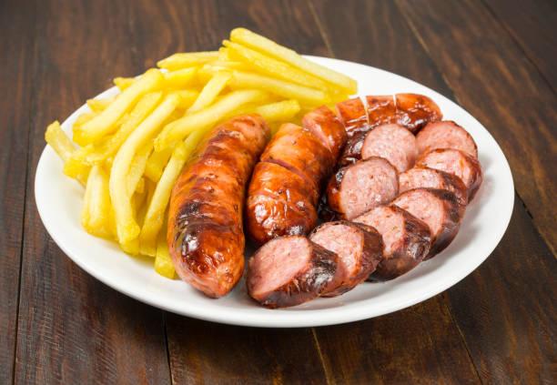 salchicha criollo con patatas fritas - studioimagen73 fotografías e imágenes de stock