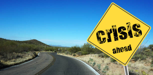 Crisis ahead sign Crisis ahead sign on a sky background and dessert road crisis stock pictures, royalty-free photos & images