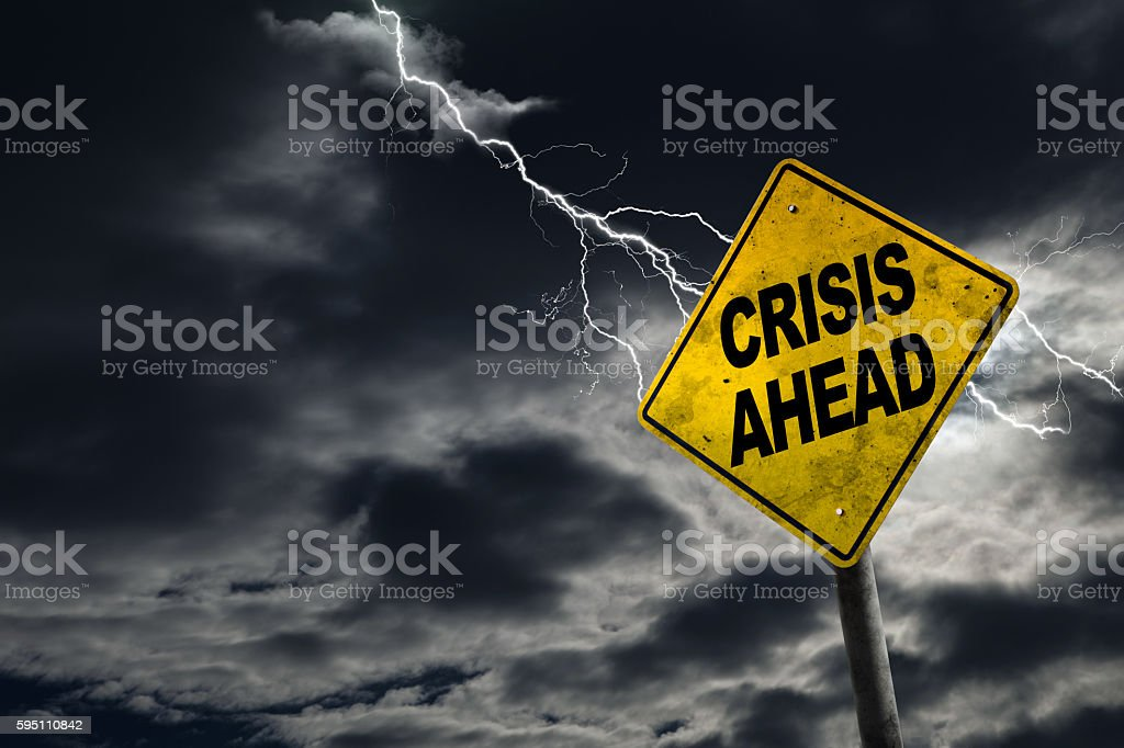 Crisis Ahead Sign With Stormy Background stock photo